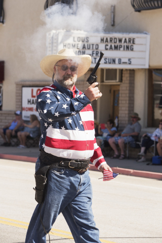 Walt Aliff participates as a gunfighter during the Beatty Fourth of July parade.