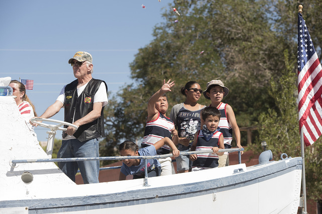 John Strozzi on a boat for the Beatty VFW Post 12108 float during the town's Fourth of July parade.  Photos by Skylar Stephens