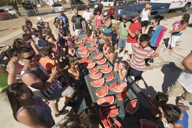 Children up to 6 years old participate in the watermelon eating contest during Beatty's Fourth of July celebration.