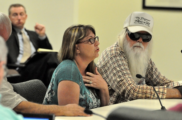 """Horace Langford Jr / Pahrump Valley Times  Kayla Mitchell and Ray """"the Flagman"""" Mielzynski speak at the Pahrump Regional Planning Commission meeting on Wednesday, July 13. The commission gave Mitc ..."""