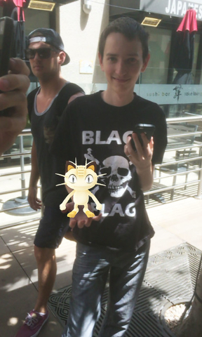 The editor's stepson Brian with a virtual Meowth while playing Pokemon Go at Town Square in Las Vegas on Sunday. Arnold M. Knightly/Pahrump Valley Times