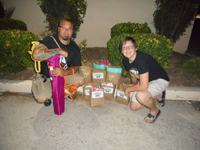 Jason Riendeau and Alex Torres help put together care packages that Pokémon Go player can hand out when they run across the homeless while playing the mobile game. Linda Zukowski/Special to the P ...
