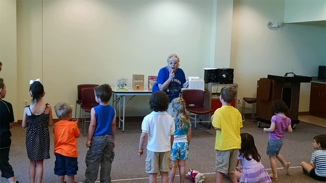 Pahrump Community Librarian Brenda Gibbons interacts with children during the library's annual Summer Reading Program in June 2015. Tuesday's summer read was the last one for Gibbons, who plans  ...