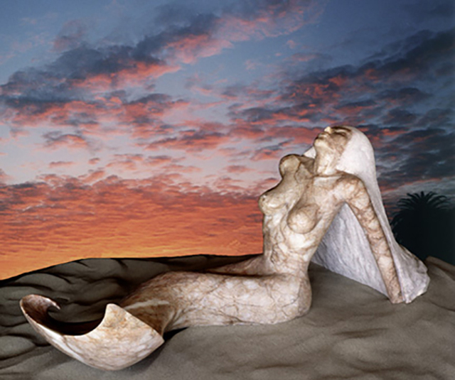 """Pete Ehrlich created a sculpture of a mermaid, """"Paula,"""" out of a five ton alabaster rock from St. George, Utah in his former Culver City, California studio. When finished, she was scaled down to ..."""