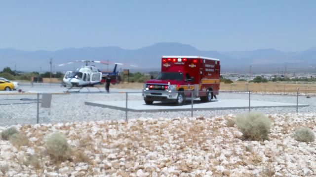 Pahrump Fire and Rescue medics carry a 4-year-old child to a waiting Mercy Air helicopter after he was found at the bottom of the family swimming pool on Monday. The boy was conscious and breathin ...