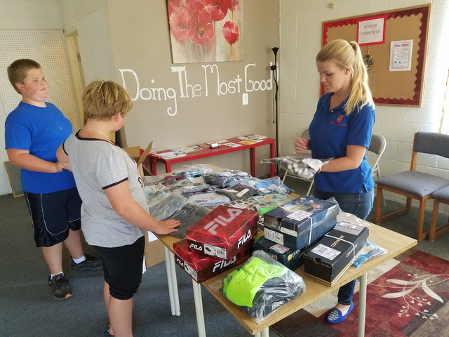 Shambra Jones, coordinator for the Salvation Army in Tonopah, on Aug. 1 helps prepare school backpacks for students in need. The effort also includes new back-to-school clothing for 20 students.   ...