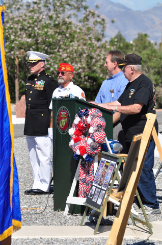 Purple Heart recipient Jerry Dumont of the Pahrump Marine Corps League, second from left, during Memorial Day services in 2015. Purple Heart Day is observed every Aug. 7, which is this Sunday. Hor ...