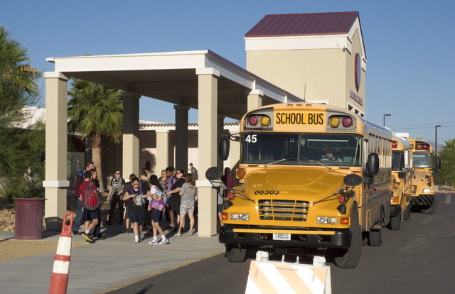 Buses line up to drop off students at Pahrump Valley High the first day of school. The Nye County School District is receiving a donation of 20 used buses from the Clark County School District. Sp ...