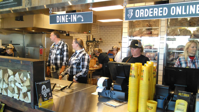 Staff and management at Dickey's Barbecue Pit prepare for tomorrow's 11 a.m., grand opening at their 240 S. Highway 160 location next to Denny's. Patrons may dine in or take out. Franchise o ...