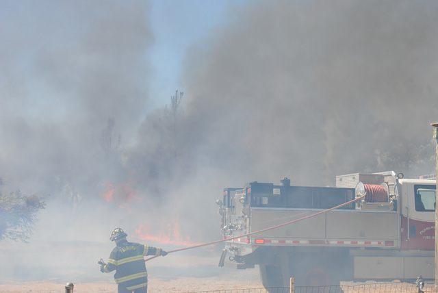 Fire crews were hampered by gusty winds Monday morning after a fire broke out on East Gamebird Road. Chief Scott Lewis said a large raven which landed on an energized power line was the cause of t ...
