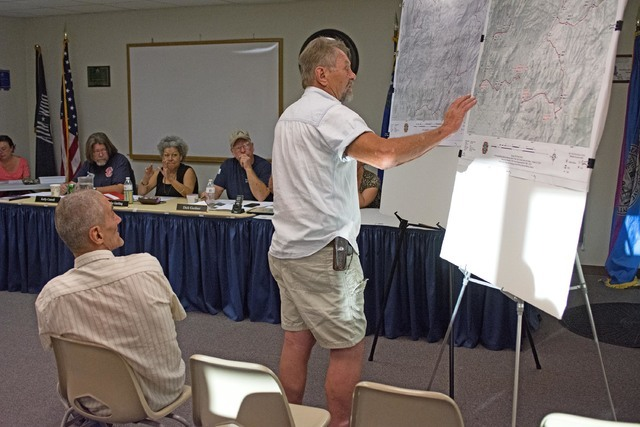 Karl Olson discussing off-road trail routes with the Beatty Town Advisory Board on Monday. Olson finds the geology and the history in the desert around Beatty fascinating and beautiful, and believ ...