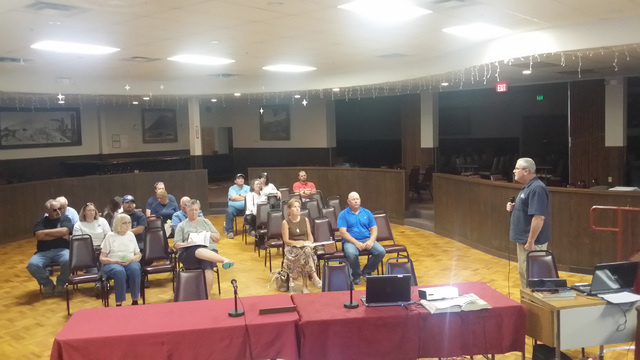Vance Payne, Nye County emergency management director, (standing right), speaks in the Tonopah Convention Center on July 27. He updated the town on the challenges facing the volunteer ambulance se ...