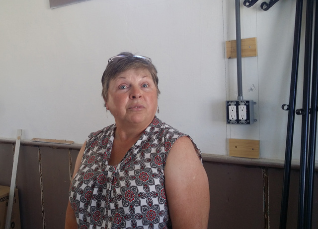 Dianne Ryals, Tonopah library director, discussing the planned work in the old library that will convert the building be used as a business office and research center. David Jacobs/Times-Bonanza & ...