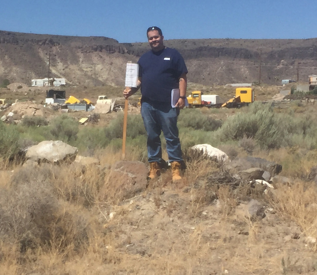 The author standing atop his land after acquiring the 2,633-square-foot lot at the Goldfield Days land auction on Saturday. Rhonda Knightly/Special to the Times-Bonanza & Goldfield News