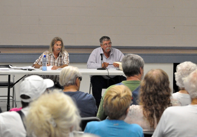 Horace Langford Jr./Pahrump Valley Times  Pahrump resident Kenny Bent and Nevada state Sen. Pete Goicoechea listen to Pahrump's well owners concerns during the meeting on Tuesday.