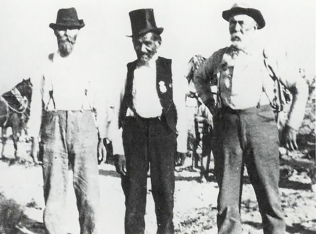 The famous Southern Paiute Chief Tecopa, center, with two area ranchers, circa 1900. Tecopa is said to have obtained his top hat and bandmaster uniform in exchange for showing a Death Valley area  ...