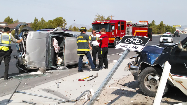 Pahrump Valley Fire and Rescue crews assess the condition of a driver who plowed into three parked vehicles at the Carlotta Business Plaza late Monday morning. The driver was transported to Desert ...