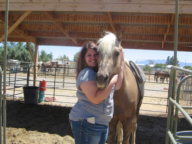 Erica Johnston with Gadget, a horse still in training for the therapeutic riding program at RNG Farms for individuals with special needs. Johnston is the owner of the farm and is a certified instr ...