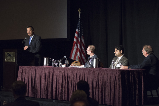 Gov. Brian Sandoval speaks during his Prescription Drug Abuse Prevention Summit in Las Vegas on Aug. 31. At the table, from left, is Scott Pattison, executive director of the National Governors As ...