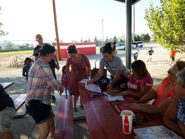 Volunteers as shown in this Aug. 25 photo are handling sign-ups for the second year of a youth soccer program in Tonopah. The program runs two evenings a week at the Joe Friel Sports Complex in To ...