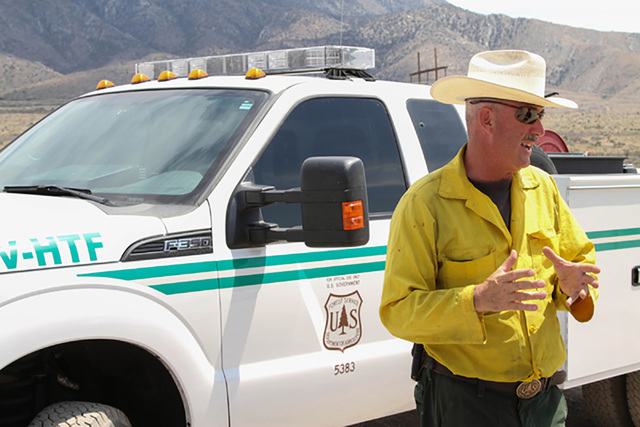 Ray Johnson, a fire prevention officer with the U.S. Forest Service, speaks to the media about the wildfire near State Route 160 and Lovell Canyon Road east of Pahrump in June. Richard Brian/Speci ...