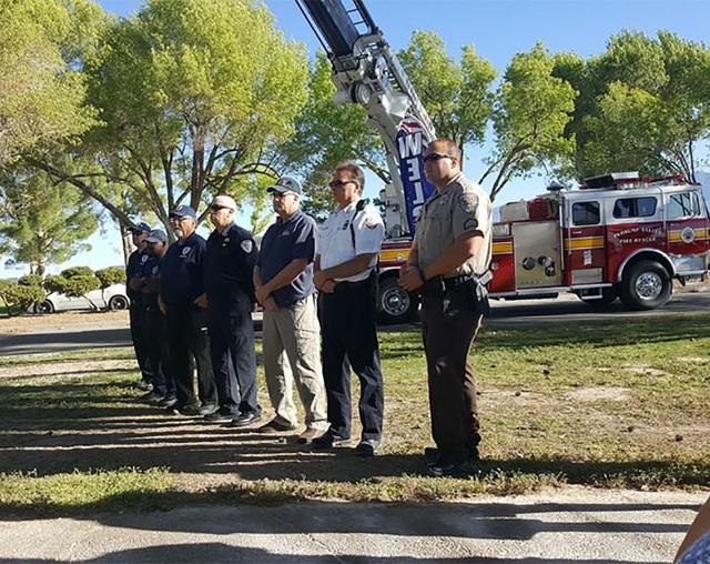 Pahrump and Nye County first responders take part in the unveiling of the new Sept. 11 Reflection Area at the Calvada Eye on Sunday. The event, hosted by the Pahrump Valley Rotary Club, was one of ...