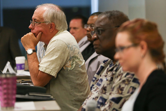 Pat Hickey, leaning forward, the Nevada coordinator for Smart Approaches to Marijuana, listens to a question during a panel discussion on the legalization of marijuana at the University of Phoenix ...