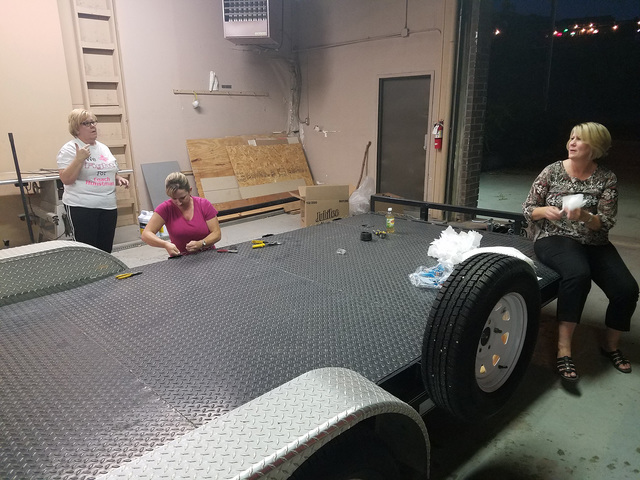 Toni North (standing), Jessica Thompson and Jennifer Klapper (seated) are working on a Tonopah High School alumni float as shown in this Sept. 6 photo. The float is being prepared for the high sch ...
