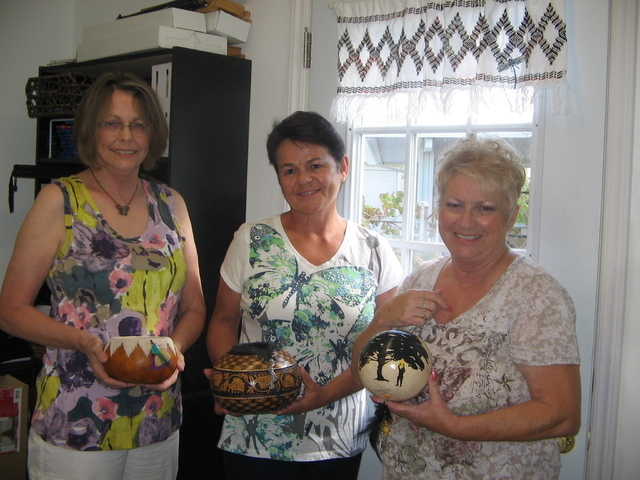 Gourd Goddesses, from left, Patti Jo Newsom, Jocelyne Lussier and Sherry Rhine display some of their gourd artwork. They are members of the Pahrump Valley Gourd Patch recently started by Newsom wh ...