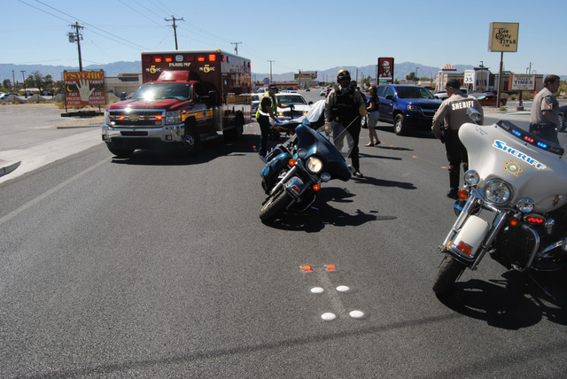 Pahrump first responders prepare to transport a motorcyclist following a two-vehicle collision along Highway 372 just west of Highway 160 Friday afternoon. The victim is expected to recover from h ...