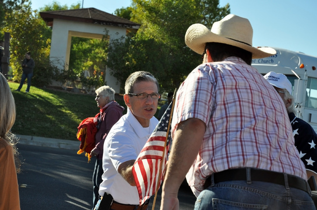 Horace Langford Jr. /Pahrump Valley Times  U.S. Senate candidate Joe Heck greeting locals before the Fall Festival Parade on Saturday. The Republican congressman from Las Vegas is seeking the sena ...