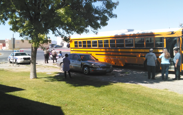No injuries were reported after a car collided with a Nye County School District bus at the intersection of Calvada and Pahrump Valley boulevards just before 1 p.m. on Tuesday. The bus carrying 32 ...