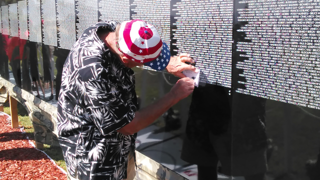 Pahrump resident Phil Huff makes a rubbing of his brother-in-law's name. Charles F. Wright was on a rescue mission when his helicopter was shot down. He was 28-years-old. The wall arrived at Sim ...