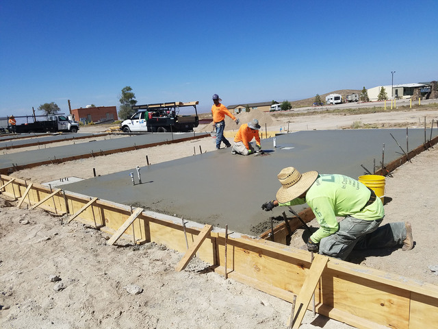 Workers are building a warehouse and self-storage building as shown in this Sept. 20 photo near U.S. Highway 95 and Radar Road. The project is through North Tonopah Development. One of the warehou ...