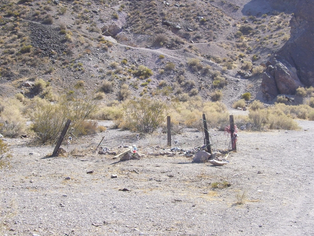 Photo of the Mona Bell grave about 2006 before the restoration by the Red Hat Society from Pahrump. The site was established in the 1950s to help build the ghost town's legend. Mona Bell's bod ...