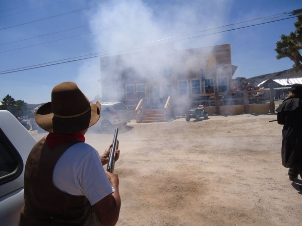 A man shoots off a gun as part of the Civil War reenactment at a past Goldfield Days event. This year's event takes place Friday, Aug. 5-7.  Special to the Pahrump Valley Times