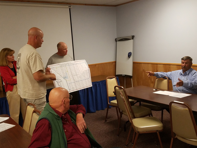Longtime rancher Joe Fallini, seated at table on the right, of the Twin Springs Ranch, speaks to the Tonopah Town Board on Sept. 14. Fallini expressed concerns about open grazing through a propose ...