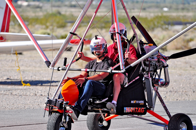 Horace Langford Jr./Pahrump Valley Times Young Eagles will take to the sky this Saturday in the annual free promotion to get kids interested in the science of flying. At a previous event, Gavin Cl ...
