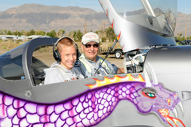 A pilot and 'Young Eagle' prepare for takeoff during a previous Young Eagle flight at the Calvada Meadows Airpark. The event returns on Saturday at 8 a.m. Anyone ages 8-to-17 can take a flight ...
