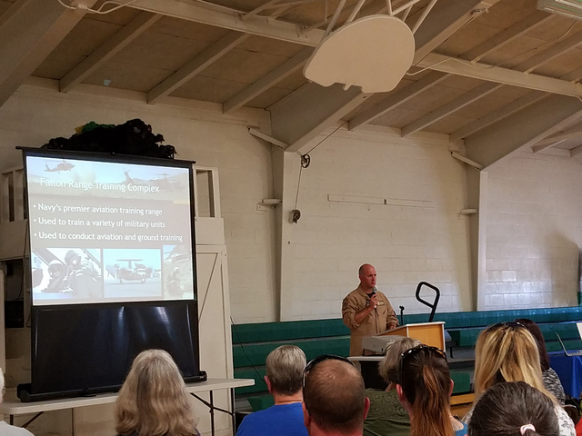 Capt. David Halloran, commanding officer of Naval Air Station Fallon, speaks to a crowd in Gabbs on Oct. 7. A public meeting was held there on the proposed expansion of the Navy's Fallon Range Tra ...