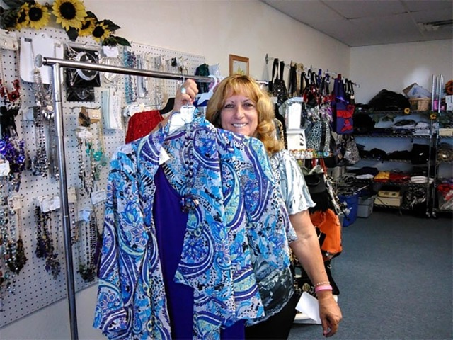 Patti Butler, owner of Sunflower Fashions provides much of the clothing for the Pahrump Valley Republican Women Fashion Show. Butler is pictured with an item from last year's event.   Special to ...