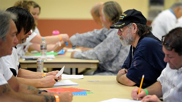 A southern Nevada veteran speaks to social service workers during a Veterans Stand Down in Clark County. Next Saturday, Pahrump's homeless veteran can take advantage of numerous services provide ...