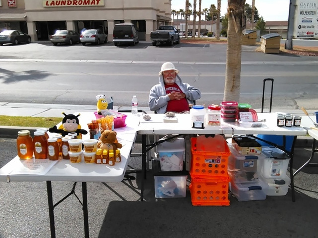 A Pahrump Farmers Market vendor awaits customers during an event in the Draft Picks parking lot earlier this year. All vendors must adhere to what's known as 'Cottage and Craft Food' state r ...