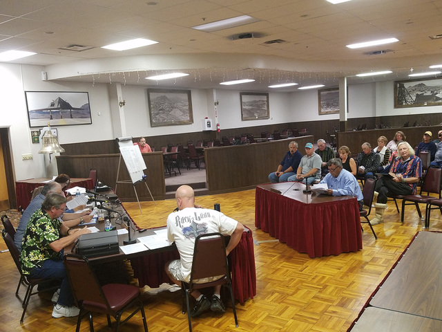 Rancher Joe Fallini, seated alone at table on right, speaks to the Tonopah Town Board  (left) during an annexation hearing Oct. 12 in the Tonopah Convention Center. The Town Board voted 4-0 to app ...