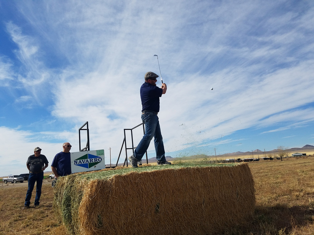 Jeff Galli tees off on a bale of hay at the 6th Annual Tonopah Cow Pasture Golf Tournament organized by the Elks Lodge of Tonopah on Oct. 22 in Stone Cabin Valley, about 35 miles east of Tonopah.  ...
