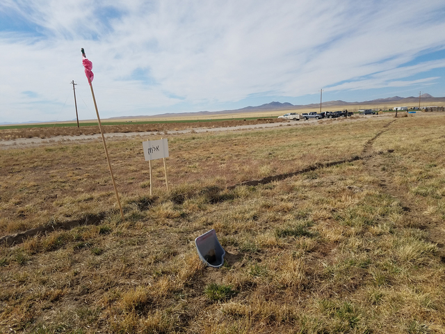 Part of a urinal serves as a hole at the 6th Annual Tonopah Cow Pasture Golf Tournament. The event raises funds for charitable causes, including Project Safe Haven, which assists abused and neglec ...
