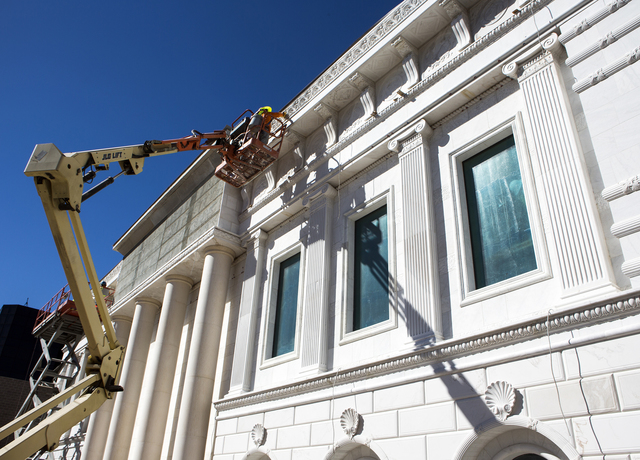 Men work on the exterior of the under construction Nevada Supreme Court building at the corner of Clark Avenue and South 4th Street on Friday, Oct. 21, 2016. The 26,132 square feet courthouse is s ...