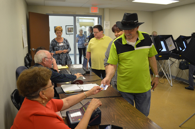 Nye County residents participate in early voting Thursday at the county clerk office on East Basin Avenue. Nye County Clerk Sandra Merino projects that voter turnout for the Nov. 8 general electio ...