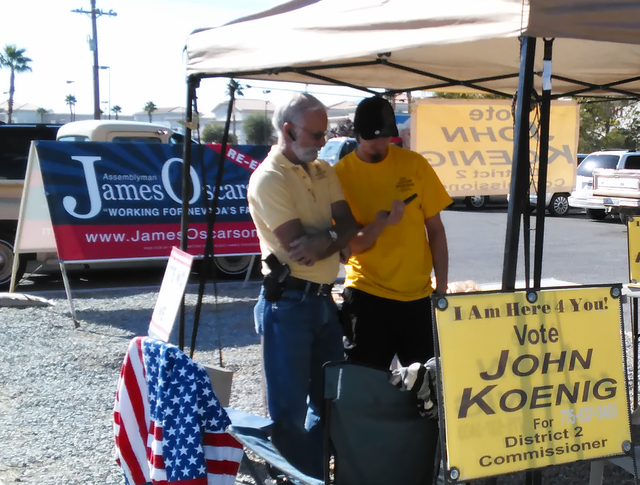 Nye County Commission Candidate John Koenig, left, at his campaign tent outside the Bob Ruub Community Center on Tuesday. The GOP candidate for District II has the only contested commission race i ...