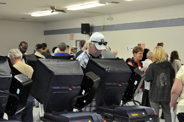 Horace Langford Jr. / Pahrump Valley Times Voters cast their ballots during a busy General Election morning on Tuesday at Bob Ruud Community Center. Ten of Pahrump's 19 precincts vote at Ruud, wit ...